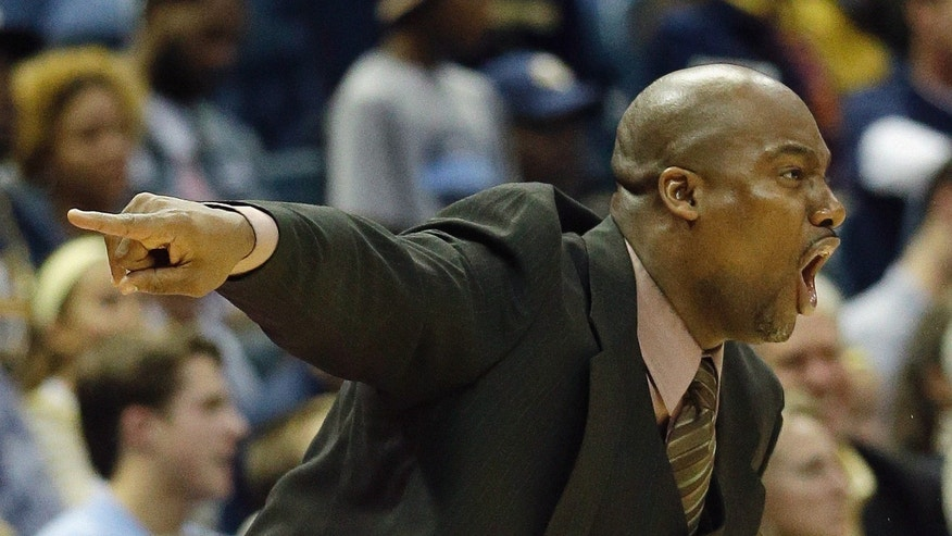 Southern University head coach Roman Banks yells to his players during the second half of an NCAA college basketball game against Marquette Friday, Nov. 8, 2013, in Milwaukee. (AP Photo/Morry Gash)