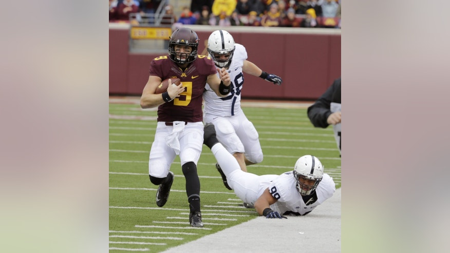 Minnesota quarterback Philip Nelson (9) leaves behind Penn State  defensive end Anthony Zettel (98) and defensive tackle Austin Johnson (99) on a 23-yard gain during the first quarter of an NCAA college football game in Minneapolis, Saturday, Nov. 9, 2013. (AP Photo/Ann Heisenfelt)