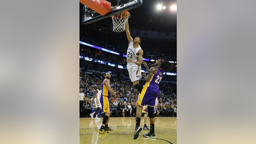 New Orleans Pelicans power forward Anthony Davis (23) dunks the ball over Los Angeles Lakers center Jordan Hill (27) in the second half of an NBA basketball game in New Orleans, Friday, Nov. 8, 2013. The Pelicans defeated the Lakers 96-85.  (AP Photo/Bill Haber)