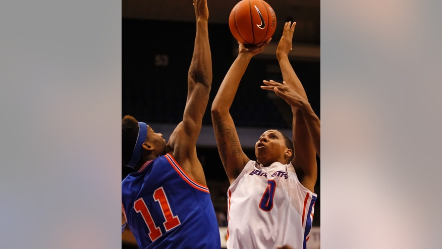Boise State's Ryan Watkins (0) shoots over UT Arlington's Brandon Williams (11) during the first half of an NCAA college basketball game in Boise, Idaho, Friday, Nov. 8, 2013. (AP Photo/Otto Kitsinger)