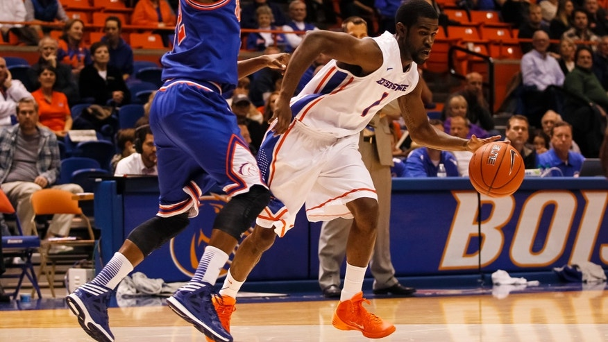 Boise State's Mikey Thompson (1) moves the ball against UT Arlington's Lonnie McClanahan during the first half of an NCAA college basketball game in Boise, Idaho, Friday, Nov. 8, 2013. (AP Photo/Otto Kitsinger)