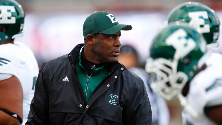 "FILE - In this Oct. 26, 2013 file photo, Eastern Michigan head coach Ron English watches his team during the first half of an NCAA college football game against Illinois, in DeKalb, Ill. Eastern Michigan has fired football coach English with three games left in a losing season also marred by tragedy.  The Eagles are 1-8 entering Saturday's game against Western Michigan. In a statement Friday, Nov. 8, 2013,  athletic director Heather Lyke says a ""change in the leadership of our football team is necessary.""  (AP Photo/Jeff Haynes, File)"
