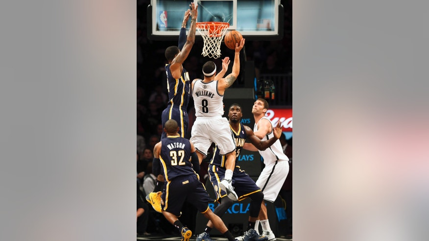 Brooklyn Nets point guard Deron Williams (8) jumps for a layup during the first quarter of an NBA basketball game, Saturday, Nov. 9, 2013, at the Barclays Center in New York. (AP Photo/John Minchillo)