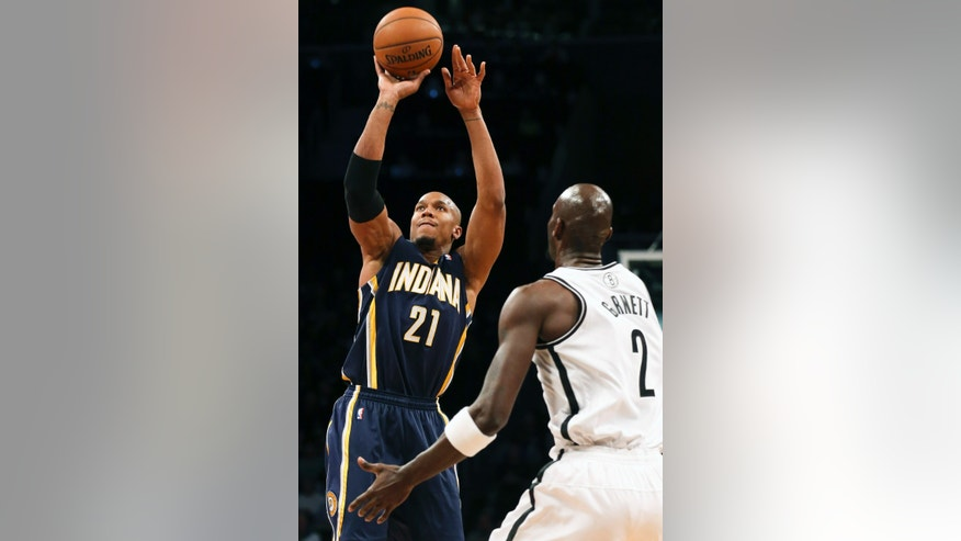 Indiana Pacers power forward David West (21) shoots the ball against Brooklyn Nets power forward Kevin Garnett (2) during the first quarter of an NBA basketball game, Saturday, Nov. 9, 2013, at the Barclays Center in New York. (AP Photo/John Minchillo)