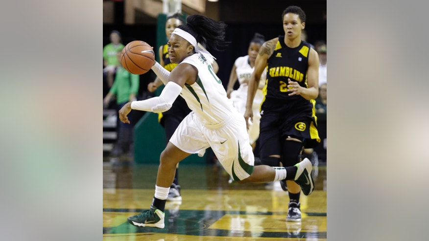 Baylor guard Odyssey Sims (0) dribbles on the fast break during the first half of an NCAA college basketball game against Grambling State on Saturday, Nov. 9, 2013, in Waco, Texas. (AP Photo/LM Otero)