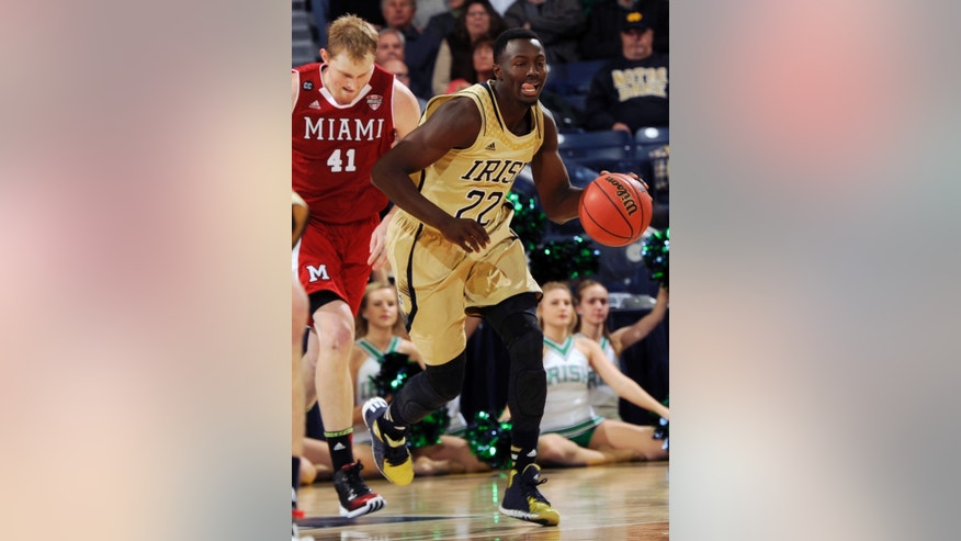 Notre Dame guard Jerian Grant (22) heads up court as Miami of Ohio Blake McLimans gives chase during the first half of a NCAA college basketball game on Friday, Nov. 8, 2013, in South Bend, Ind.  (AP Photo/Joe Raymond)