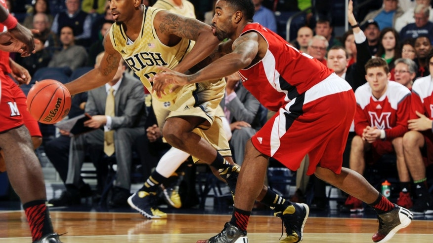 Notre Dame guard Eric Atkins drives as Miami of Ohio guard Quinten Rollins, right, defends during the first half of a NCAA college basketball game on Friday, Nov. 8, 2013, in South Bend, Ind.  (AP Photo/Joe Raymond)