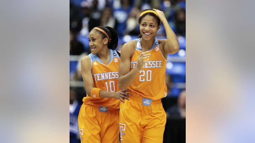 Tennessee center Isabelle Harrison (20) and guard Meighan Simmons (10) celebrate late in the second half of an NCAA college basketball game against Middle Tennessee, Friday, Nov. 8, 2013, in Murfreesboro, Tenn. Tennessee won 67-57. (AP Photo/Mark Humphrey)