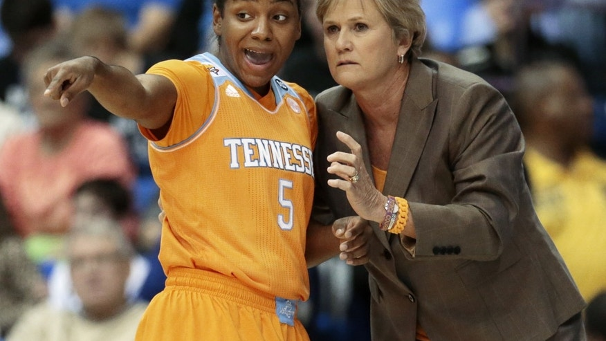 Tennessee head coach Holly Warlick, right, talks with guard Ariel Massengale (5) in the first half of an NCAA college basketball game against Middle Tennessee, Friday, Nov. 8, 2013, in Murfreesboro, Tenn. (AP Photo/Mark Humphrey)