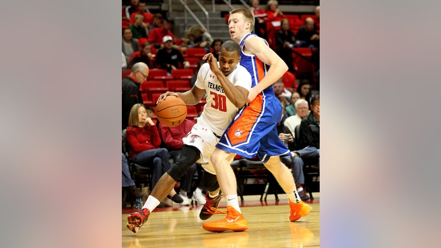 Texas Tech's Jaye Crockett drives against Houston Baptist's Alex Fountain during an NCAA college basketball game in Lubbock, Texas, Friday, Nov. 8, 2013. (AP Photo/Lubbock Avalanche-Journal,Tori Eichberger)
