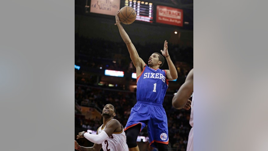 Philadelphia 76ers' Michael Carter-Williams (1) shoots over Cleveland Cavaliers' Kyrie Irving (2) during the first quarter of an NBA basketball game Saturday, Nov. 9, 2013, in Cleveland. (AP Photo/Tony Dejak)