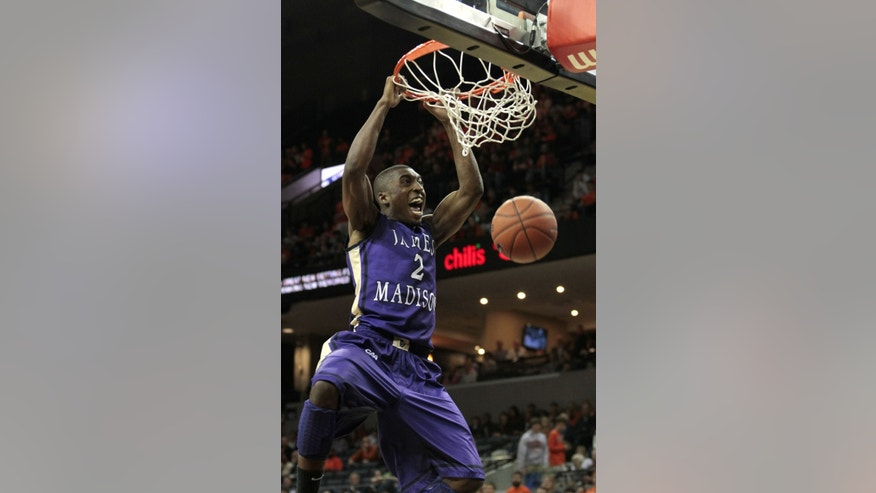 James Madison guard Ron Curry (2) dunks on an open basket against Virginia during the first half of an NCAA college basketball game on Friday, Nov. 8, 2013, in Charlottesville, Va. (AP Photo/Ryan M. Kelly)
