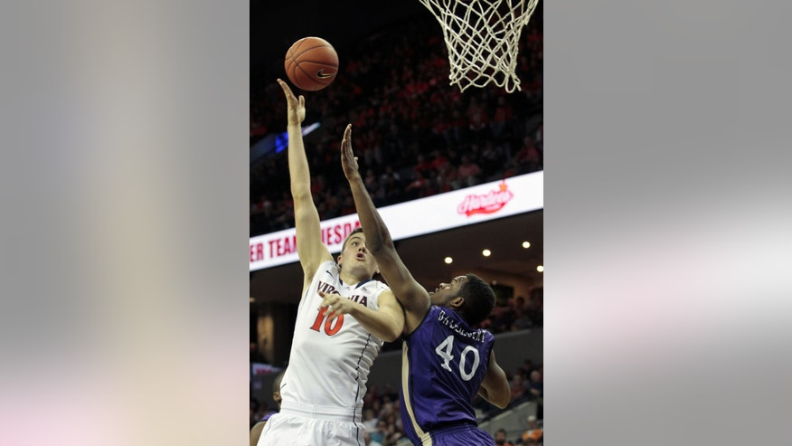 Virginia forward Mike Tobey (10) makes a layup over James Madison forward Yohanny Dalembert (40) during the second half of an NCAA college basketball game on Friday, Nov. 8, 2013, in Charlottesville, Va. (AP Photo/Ryan M. Kelly)