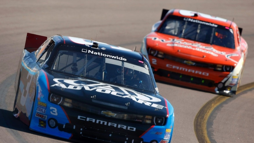 Nationwide Series driver Austin Dillon (3), left, battles with Nationwide Series driver Brian Scott (2) for position during Servicemaster 200 Auto Race on Saturday, Nov. 9, 2013, in Avondale, Ariz. The Nascar Advocare 500 Auto Race will be run on Sunday. (AP Photo/Rick Scuteri)