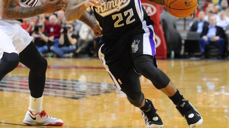 Sacramento Kings' Isaiah Thomas (22) drives against Portland Trail Blazers' Mo Williams (25) during the first half of an NBA basketball game in Portland, Ore., Friday Nov. 8, 2013. (AP Photo/Greg Wahl-Stephens)