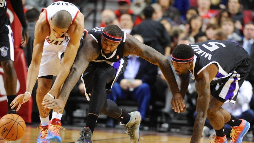 Sacramento Kings' John Salmons (5) and DeMarcus Cousins (15) defend against Portland Trail Blazers' Nicolas Batum (88) during the first half of an NBA basketball game in Portland, Ore., Friday Nov. 8, 2013. (AP Photo/Greg Wahl-Stephens)