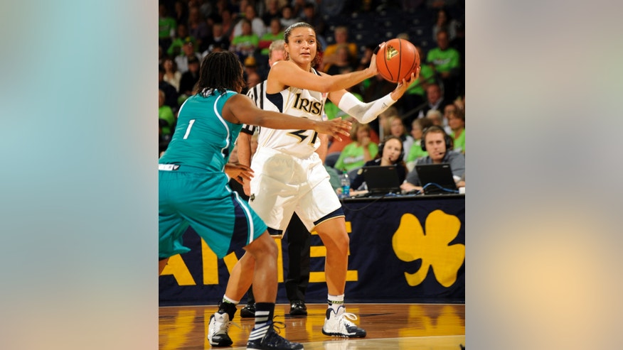 Notre Dame guard Kayla McBride, right, passes against  UNC-Wilmington during the first half of a NCAA college basketball game, Saturday, Nov. 9, 2013, in South Bend, Ind. (AP Photo/Joe Raymond)