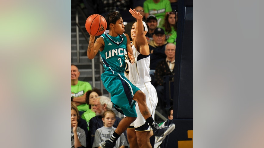 UNC-Wilmington guard Kelva Atkins, left, drives the lane as Notre Dame guard Taya Reimer defends during the first half of an NCAA college basketball game, Saturday, Nov. 9, 2013, in South Bend, Ind. (AP Photo/Joe Raymond)