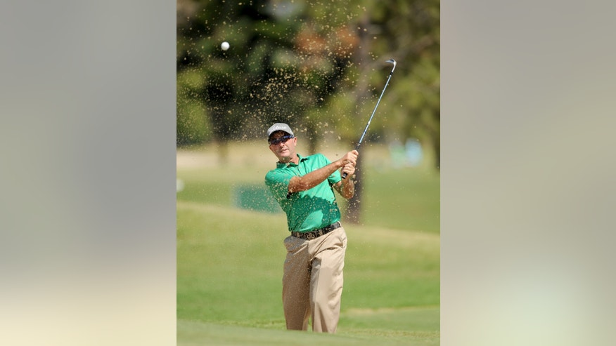 In this photo released by OneAsia, David McKenzie of Australia plays a shot during the second round of the Australian PGA Championship at the RACV Royal Pines Resort golf club on Australia's Gold Coast Friday, Nov. 8, 2013. (AP Photo/OneAsia, Khalid Redza) NO LICENSING