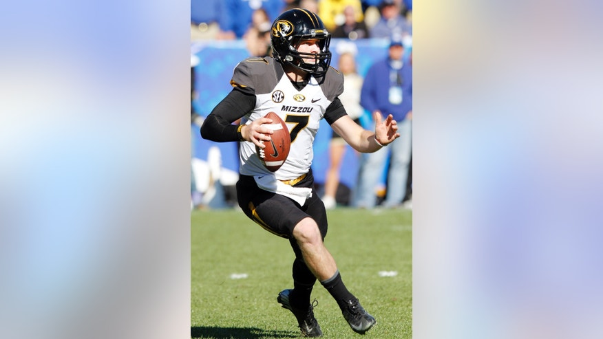 Missouri quarterback Maty Mauk (7) scrambles during the second quarter of an NCAA college football game against Kentucky, Saturday, Nov. 9, 2013, in Lexington, Ky. (AP Photo/James Crisp)