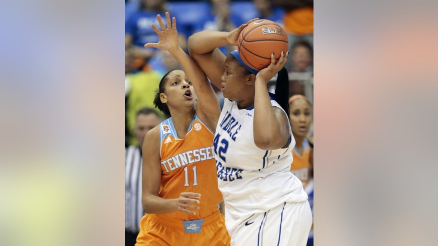 Tennessee forward Cierra Burdick (11) defends against Middle Tennessee center KeKe Stewart (42) in the second half of an NCAA college basketball game on Friday, Nov. 8, 2013, in Murfreesboro, Tenn. Tennessee won 67-57. (AP Photo/Mark Humphrey)