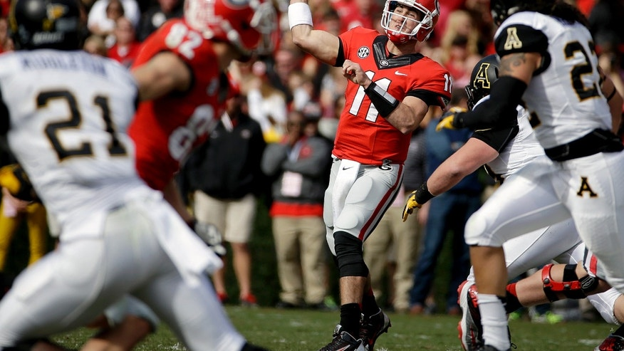 Georgia quarterback Aaron Murray throws a pass in the second quarter of an NCAA college football game against Appalachian State, Saturday, Nov. 9, 2013, in Athens, Ga. (AP Photo/David Goldman)