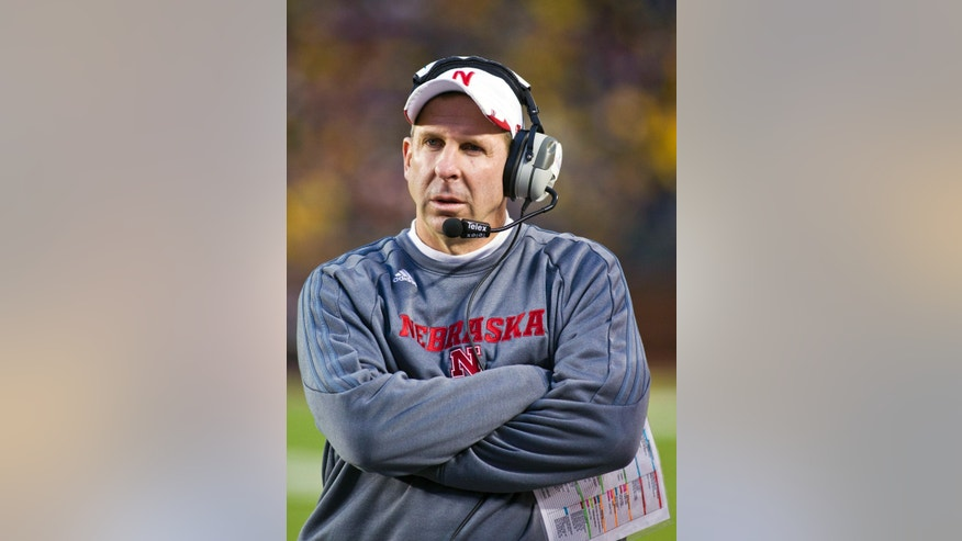 Nebraska coach Bo Pelini, stands on the sideline during a timeout in the second quarter of Nebraska's NCAA college football game against Michigan in Ann Arbor, Mich., Saturday, Nov. 9, 2013. (AP Photo/Tony Ding)