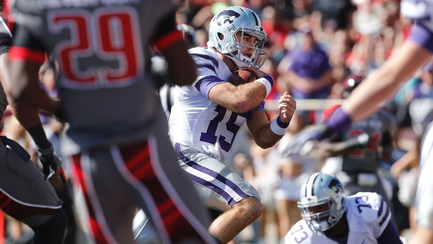 Kansas State's Jake Waters(15) scores a touchdown against Texas Tech during the first half of an NCAA college football game in Lubbock, Texas, Saturday, Nov. 9, 2013. (AP Photo/Lubbock Avalanche-Journal, Stephen Spillman) ALL LOCAL TV OUT