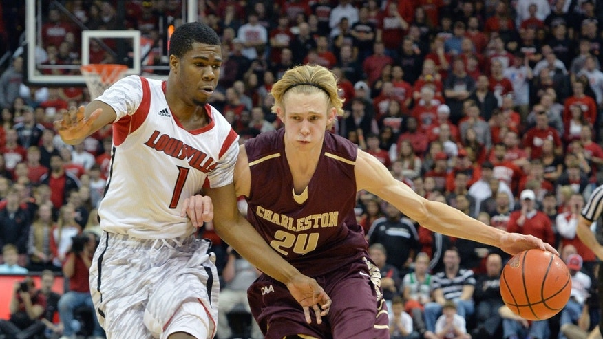 College of Charleston's Chad Cooke, right, attempts to drive around the defense of Louisville's Anton Gill during the first half of an NCAA college basketball game, Saturday, Nov. 9, 2013, in Louisville, Ky. (AP Photo/Timothy D. Easley)