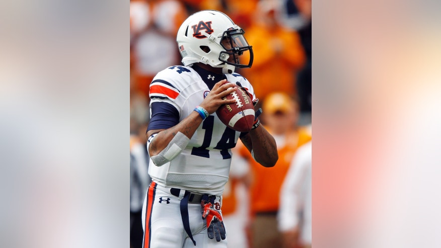 Auburn quarterback Nick Marshall (14) looks for a receiver in the first quarter of an NCAA college football game against Tennessee on Saturday, Nov. 9, 2013, in Knoxville, Tenn. (AP Photo/Wade Payne)