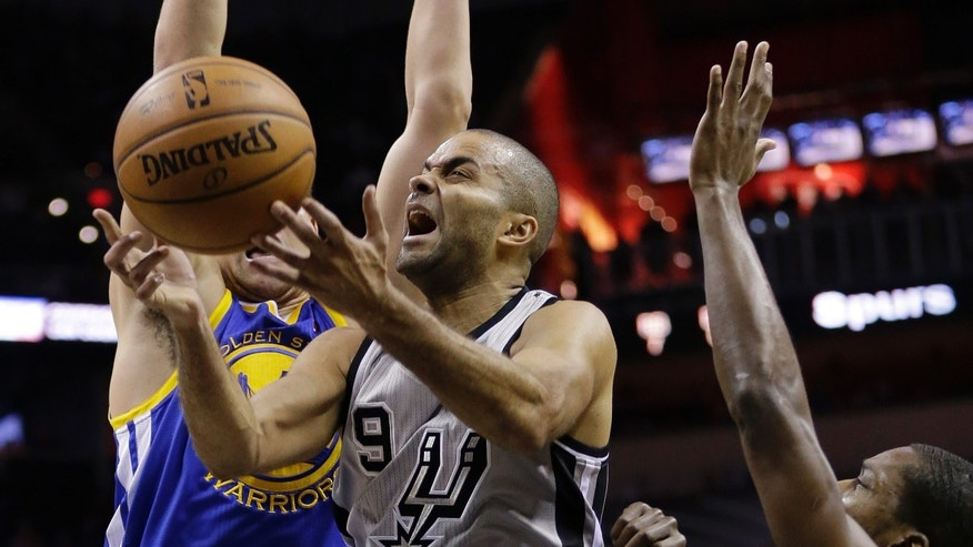San Antonio Spurs' Tony Parker (9), of France, is fouled as he drives between Golden State Warriors' Klay Thompson, left, and Toney Douglas during the first half of an NBA basketball game, Friday, Nov. 8, 2013, in San Antonio. (AP Photo/Eric Gay)