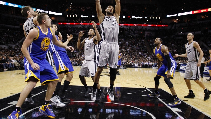 San Antonio Spurs' Tim Duncan (21) pulls down a defensive rebound against the Golden State Warriors during the first half of an NBA basketball game, Friday, Nov. 8, 2013, in San Antonio. (AP Photo/Eric Gay)