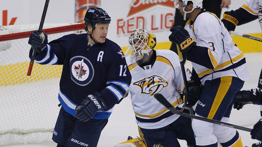 Winnipeg Jets' Olli Jokinen (12) celebrates his goal against Nashville Predators goaltender Carter Hutton during the first period of an NHL hockey game Friday, Nov. 8, 2013, in Winnipeg, Manitoba. (AP Photo/The Canadian Press, John Woods)