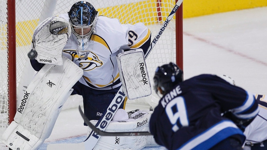 Nashville Predators goaltender Marek Mazanec makes a save on Winnipeg Jets' Evander Kane during the first period of an NHL hockey game Friday, Nov. 8, 2013, in Winnipeg, Manitoba. (AP Photo/The Canadian Press, John Woods)