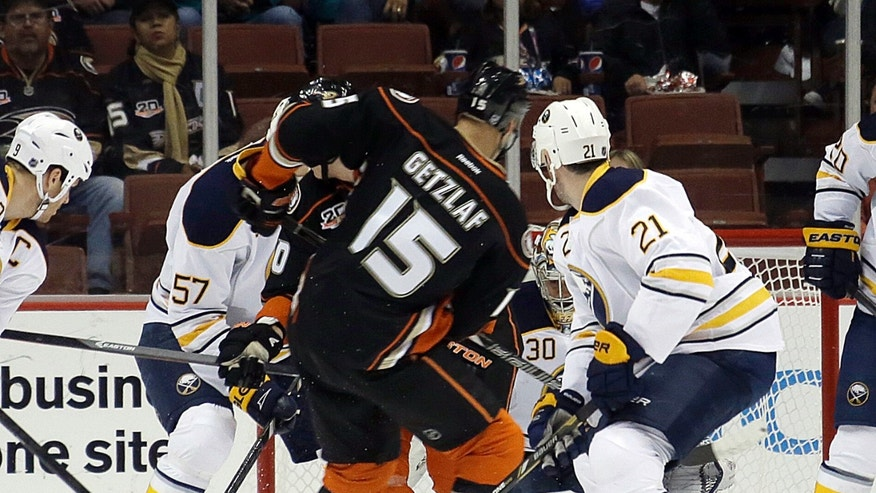 Anaheim Ducks center Ryan Getzlaf (15) fires through a crowd for his first of three goals in the first period against the Buffalo Sabres in the first period of an NHL hockey game in Anaheim, Calif., Friday, Nov. 8, 2013. (AP Photo/Reed Saxon)