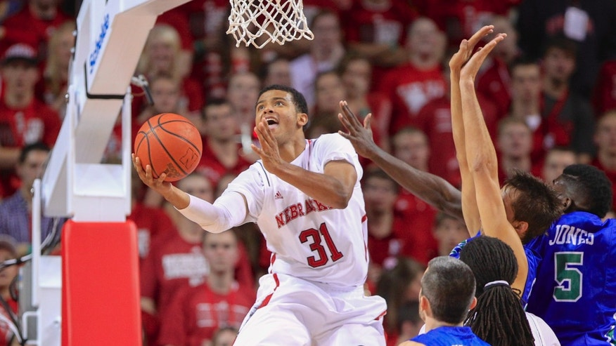 Nebraska guard Shavon Shields (31) goes for a basket against Florida Gulf Coast guard Brett Comer (0) and guard Jamail Jones (5), in the first half of an NCAA college basketball game in Lincoln, Neb., Friday, Nov. 8, 2013. (AP Photo/Nati Harnik)