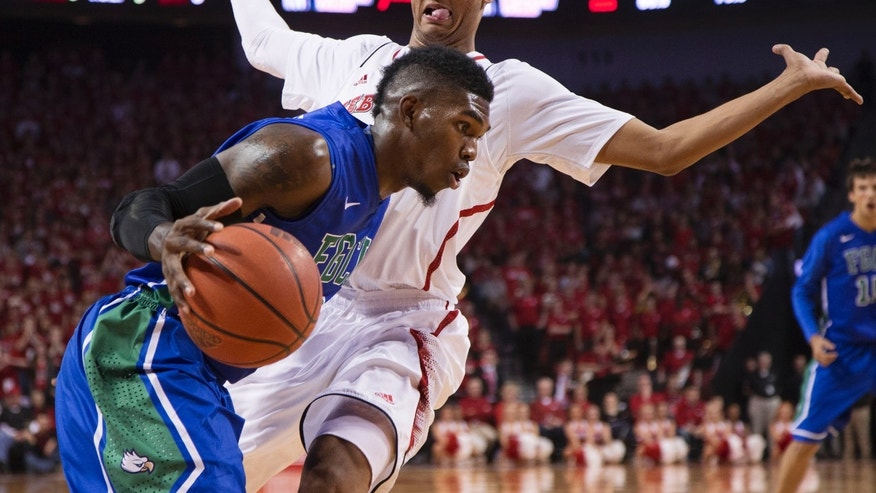 Florida Gulf Coast guard Jamail Jones, left, drives past Nebraska guard Shavon Shields during the first half of an NCAA college basketball game in Lincoln, Neb., Friday, Nov. 8, 2013. (AP Photo/Nati Harnik)