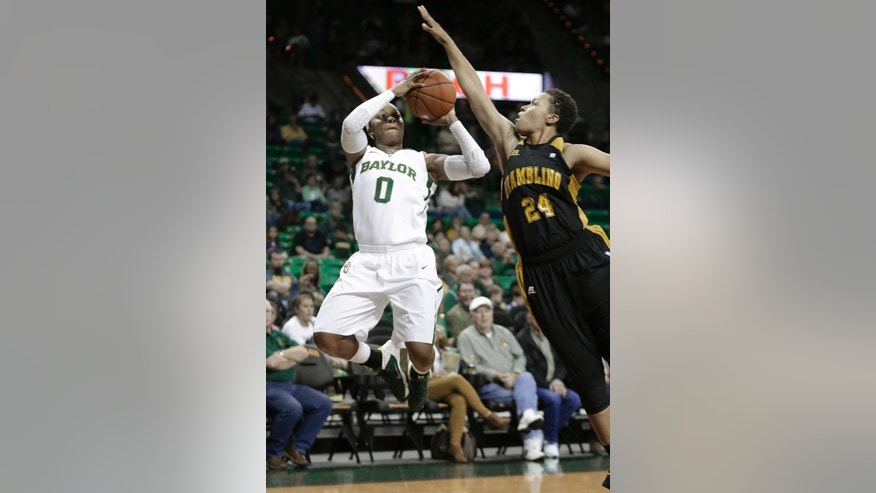Baylor guard Odyssey Sims (0) shoots against Grambling State forward Jessica Watkins (24) during the first half of an NCAA college basketball game Saturday, Nov. 9, 2013, in Waco, Texas. (AP Photo/LM Otero)
