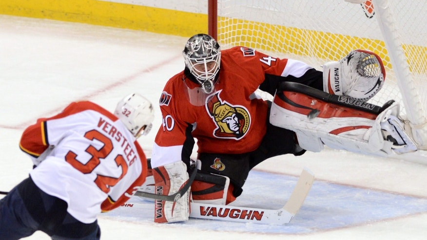 Ottawa Senators' Robin Lehner makes a save on a shot from Florida Panthers' Kris Versteeg during first period NHL hockey game in Ottawa, Ontario, on Saturday, Nov. 9, 2013. (AP Photo/The Canadian Press, Sean Kilpatrick)