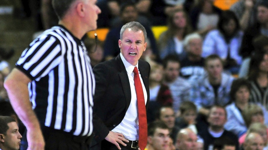 Southern California coach Andy Enfield yells at an official during an NCAA college basketball game against Utah State, Friday, Nov. 8, 2013, in Logan, Utah. (AP Photo/Herald Journal, John Zsiray)