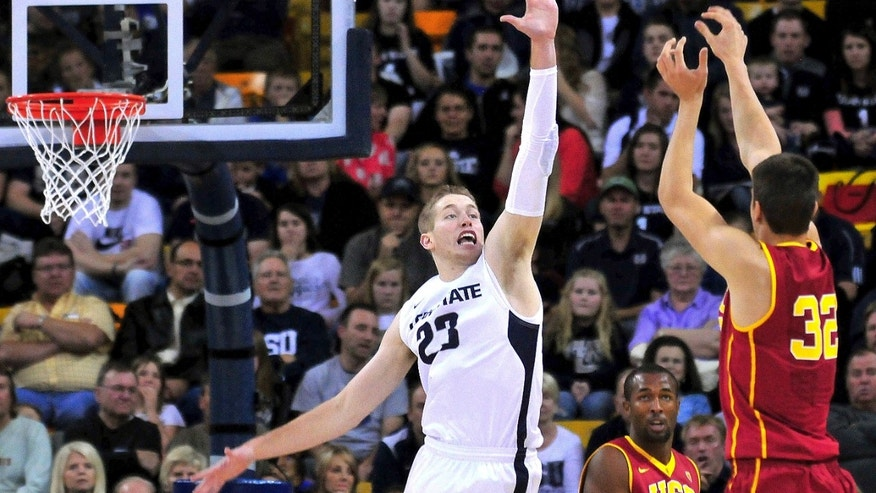 Southern California's Nikola Jovanovic (32) shoots over Utah State's Kyle Davis (23) during an NCAA college basketball game, Friday, Nov. 8, 2013, in Logan, Utah. (AP Photo/Herald Journal, John Zsiray)