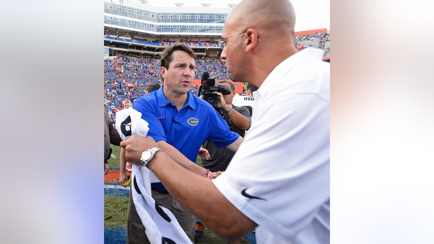 Florida coach Will Muschamp, left, congratulates Vanderbilt coach James Franklin, right, after Vanderbilt defeated Florida 34-17 in NCAA college football game Saturday, Nov. 9, 2013 in Gainesville, Fla.  (AP Photo/Phil Sandlin)