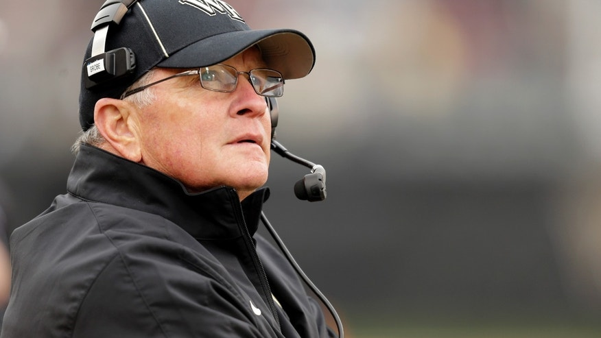 Wake Forest head coach Jim Grobe looks at the scoreboard as his team plays Florida State in the second half of an NCAA college football game in Winston-Salem, N.C., Saturday, Nov. 9, 2013. Florida State won 59-3. (AP Photo/Nell Redmond)