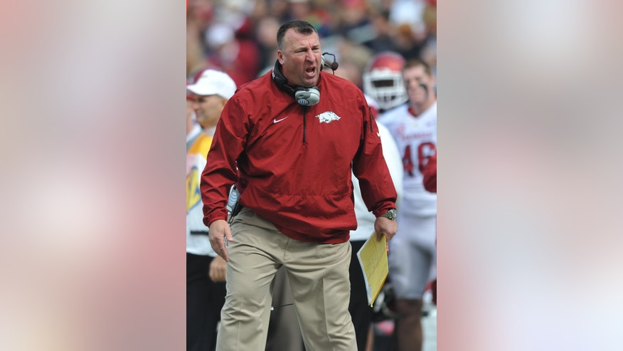 Arkansas coach Bret Bielema reacts to a play during an NCAA college football game against Mississippi at Vaught-Hemingway Stadium Saturday, Nov. 9, 2013, in Oxford, Miss. (AP Photo/Oxford Eagle, Bruce Newman) MAGS OUT, NO SALES, MANDATORY CREDIT