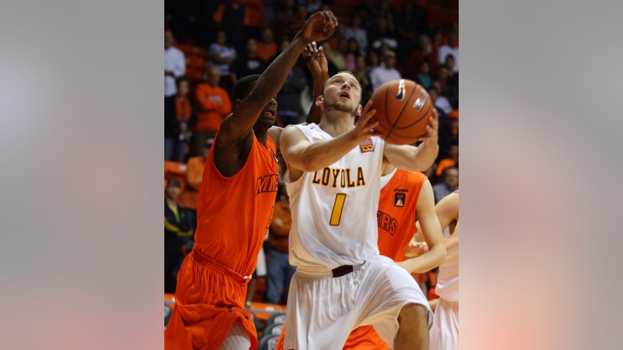 Loyola' of New Orleans' Kyle Simmons puts up a shot against UTEP's Julian Washburn during the first half of an NCAA college basketball game Saturday, Nov. 9, 2013, in El Paso, Texas. (AP Photo/El Paso Times, Victor Calzada) EL PASO  OUT  JUAREZ, MEXICO, OUT