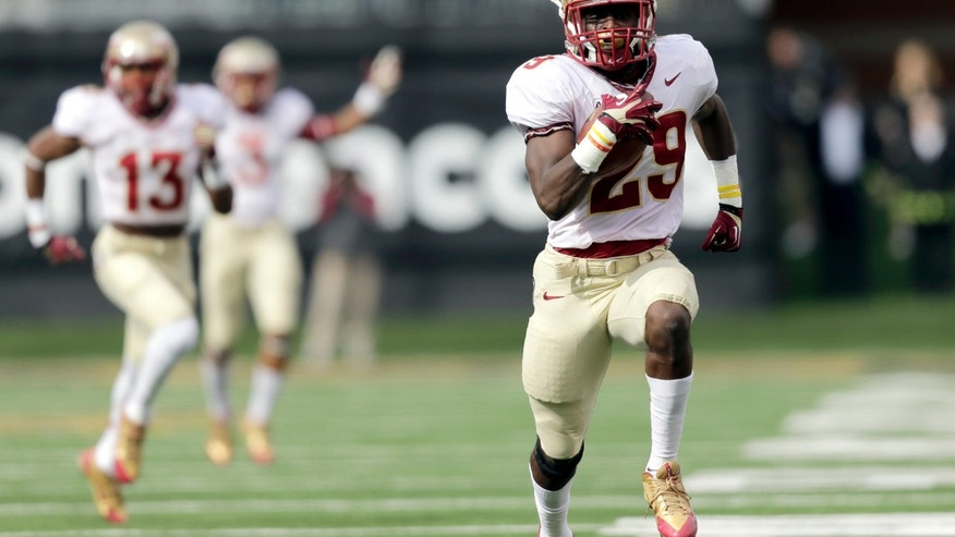 Florida State defensive back Nate Andrews (29) runs back an interception for a touchdown against Wake Forest in the first half of an NCAA college football game in Winston-Salem, N.C., Saturday, Nov. 9, 2013. (AP Photo/Nell Redmond)