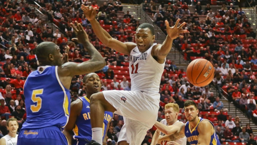 San Diego State guard D'Erryl Williams, center, has the ball knocked away on a drive to the basket by UC Riverside 's Steven Jones, second from front left, as Riverside's Taylor Johns helps out during the first half of a NCAA college basketball game on Friday, Nov. 8, 2013, in San Diego. (AP Photo/Lenny Ignelzi)
