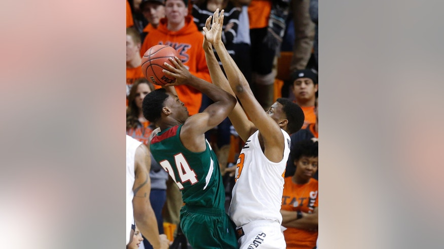 Mississippi Valley State guard Anthony McDonald (24) shoots as Oklahoma State wing Leyton Hammonds (23) defends in the first half of an NCAA college basketball game in Stillwater, Okla., Friday, Nov. 8, 2013. Oklahoma State won 117-62. (AP Photo/Sue Ogrocki)