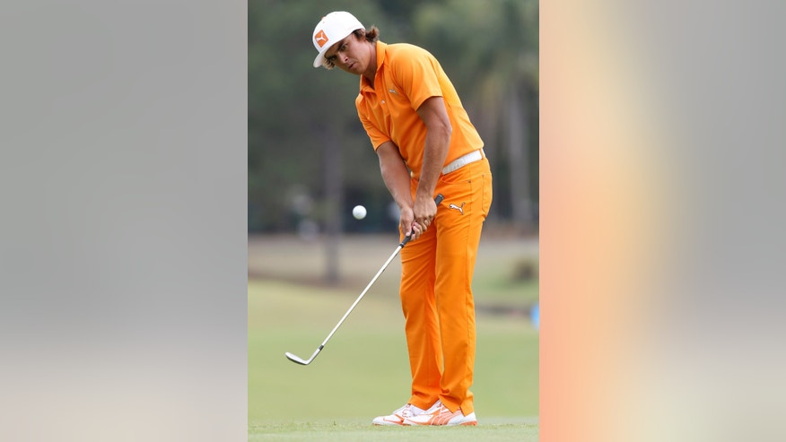 Rickie Fowler of the United States chips on the 10th green during the final round of the Australian PGA golf championship held at the Royal Pines Resort, on the Gold Coast, in Australia, Sunday, Nov. 10, 2013. (AP Photo/Tertius Pickard)