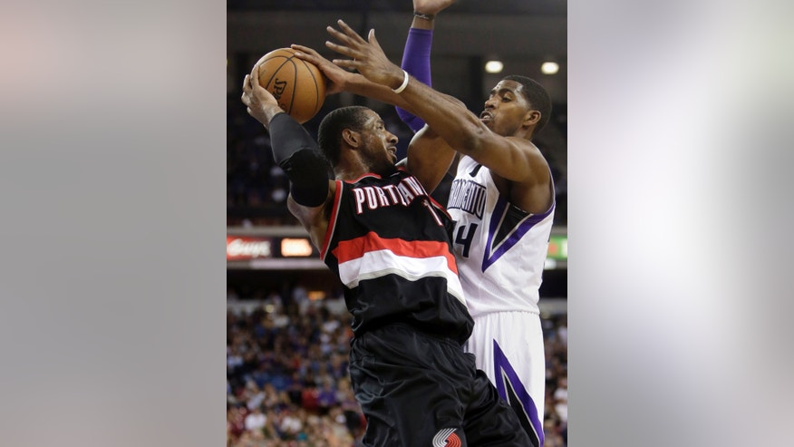 Portland Trail Blazers center LaMarcus Aldridge, left, protects the ball from Sacramento Kings  forward Jason Thompson during the first quarter of an NBA basketball game in Sacramento, Calif., Saturday, Nov. 9, 2013. (AP Photo/Rich Pedroncelli)